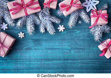 Festive Christmas border with decorative gifts tied with red...