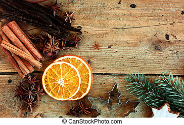Christmas border with traditional spices including cinnamon,...