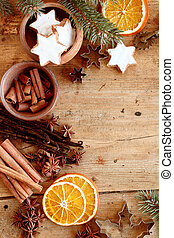 Christmas spices and cookies in a festive frame with star...
