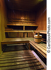 Sauna - Empty wooden sauna with a bucket of water