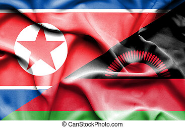 Waving flag of Malawi and North Korea