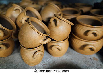 There are many terracotta clay pots - There are many clay...