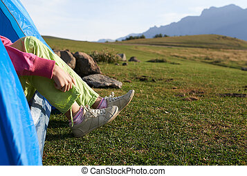 girl wearing trainers  in the mountains