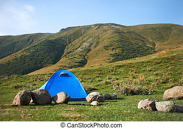 There ia a tent in the hills - There ia a blue tent in the...