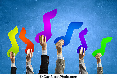 Music note - Group of people hands holding colorful music...