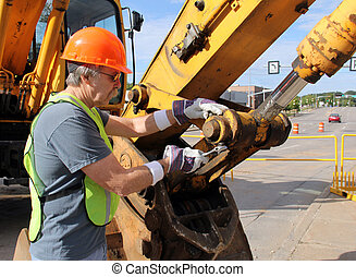 Equipment Mechanic - Heavy equipment mechanic working with a...