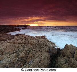 Sunrise in Sardinia - Beautiful sunrise over the sea on...