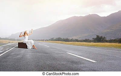 She is traveling light - Woman in white long dress and hat...
