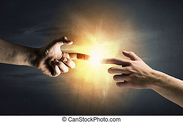 Stay in touch - Close up of human hands reaching each other...