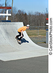Skateboard Ramp - Portrait of a young skateboarder skating...