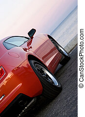 Modern Sports Car - A modern sports car parked at the beach...