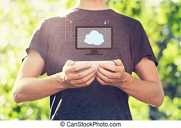 Cloud Computing concept with young man holding his smartphone