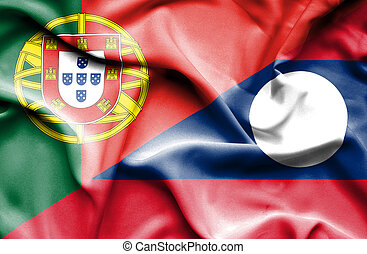 Waving flag of Laos and Portugal
