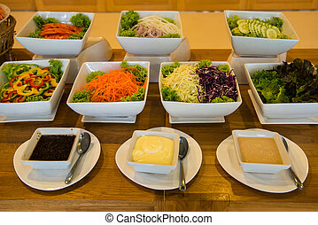 Salad bar with a variety of vegetables served buffet -...