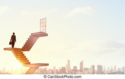 Way to success - Businessman walking up staircase to door in...