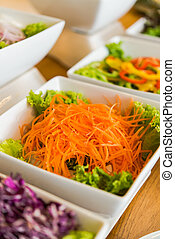 Salad bar with a variety of vegetables served buffet. -...