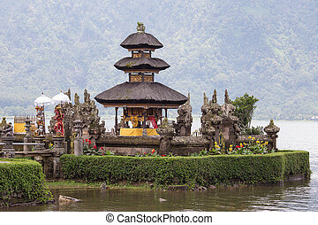 Temple Ulun Danu Bratan on the lake in Bali , Indonesia -...