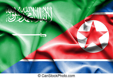 Waving flag of North Korea and Saudi Arabia