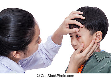 Boy with an injured eye. Doctor examining and first aid a...