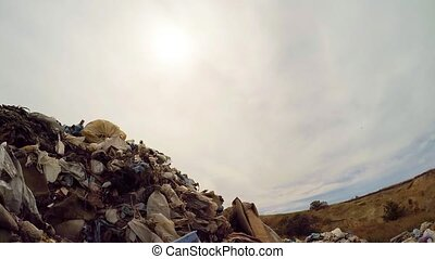 Sun In Grey Sky Over Garbage Landfill In Ukraine - Low angle...