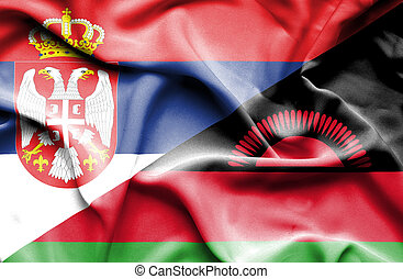 Waving flag of Malawi and Serbia