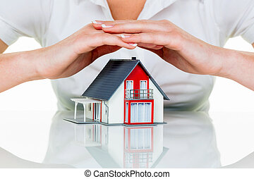 house is protected - a woman protects your house and home....
