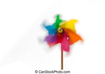Colored pinwheel spinning.