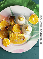 Chicken with oranges above view - Chicken baked oranges on a...