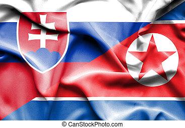 Waving flag of North Korea and Slovak