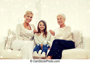 smiling family at home - family, happiness, generation and...