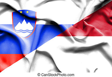 Waving flag of Indonesia and Slovenia