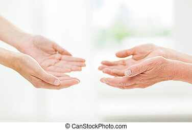 close up of senior and young woman hands - people, age,...