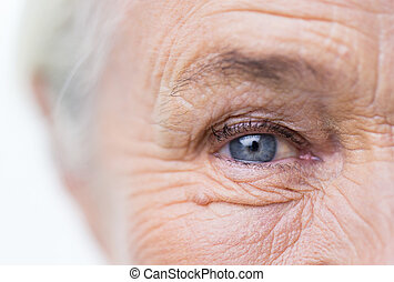 close up of senior woman face and eye - age, vision and old...