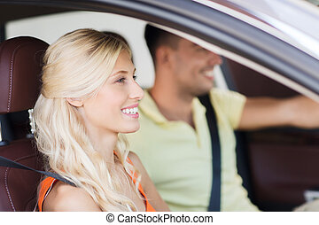 happy man and woman driving car - transport, leisure, road...
