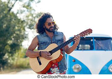 hippie man playing guitar over minivan car outdoor - nature,...
