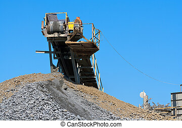 Quarry 4 - Stone conveyor belt on the skyline of pile of...