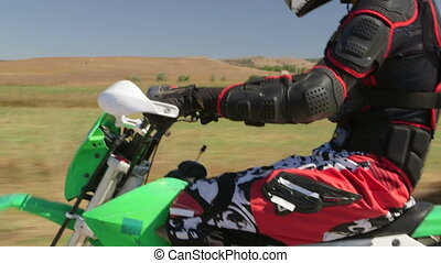 Enduro riding closeup - Motocross racer riding dirt bike,...