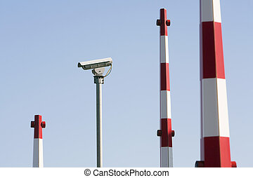 Security system - Security camera and barriers of a security...