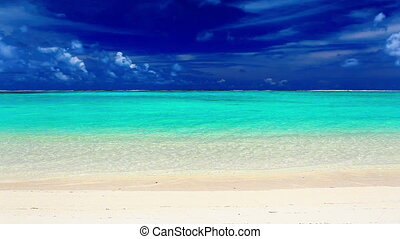 Waves on a deserted tropical beach, Cook Islands