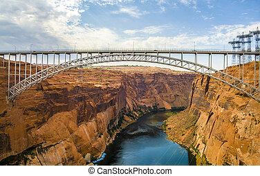 old navajo bridge crosses the colorado canyon - old navajo...