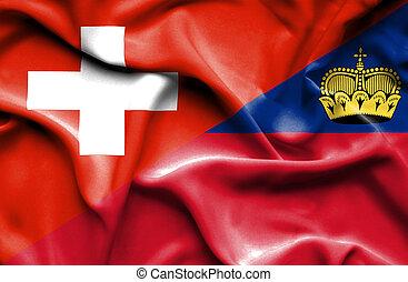 Waving flag of Lichtenstein and Switzerland - Waving flag of...