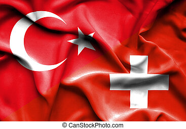 Waving flag of Switzerland and Turkey