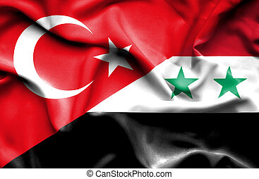 Waving flag of Syria and Turkey