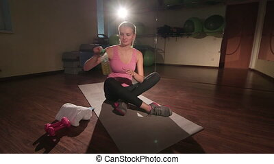 Fit woman improving flexibility doing lower body stretch pan...