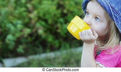 Child with plastic cup