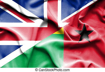 Waving flag of Guinea Bissau and Great Britain - Waving flag...