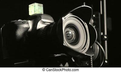 Remote hot head camera crane closeup in dark studio