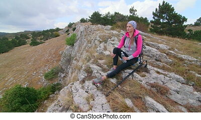 JIB CRANE: Fit young woman hiking highlands in Crimean...