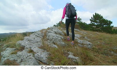 JIB CRANE: Woman day hiking in Crimean mountains walking...