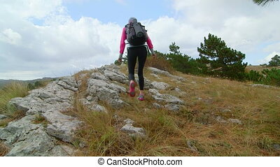 Woman hiker reached high point mountain plateau raising...